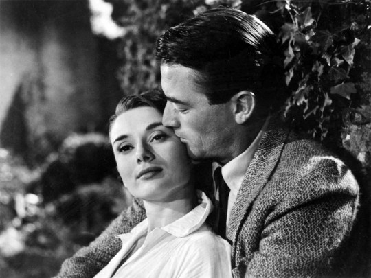 Hepburn and Peck in each others arms