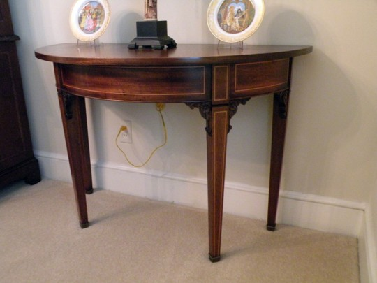 T J Stone half-moon table