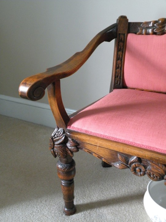 T J Stone carved settee arm